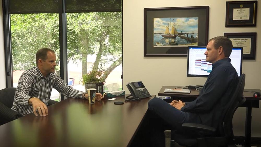 Executives Talking Through Solution