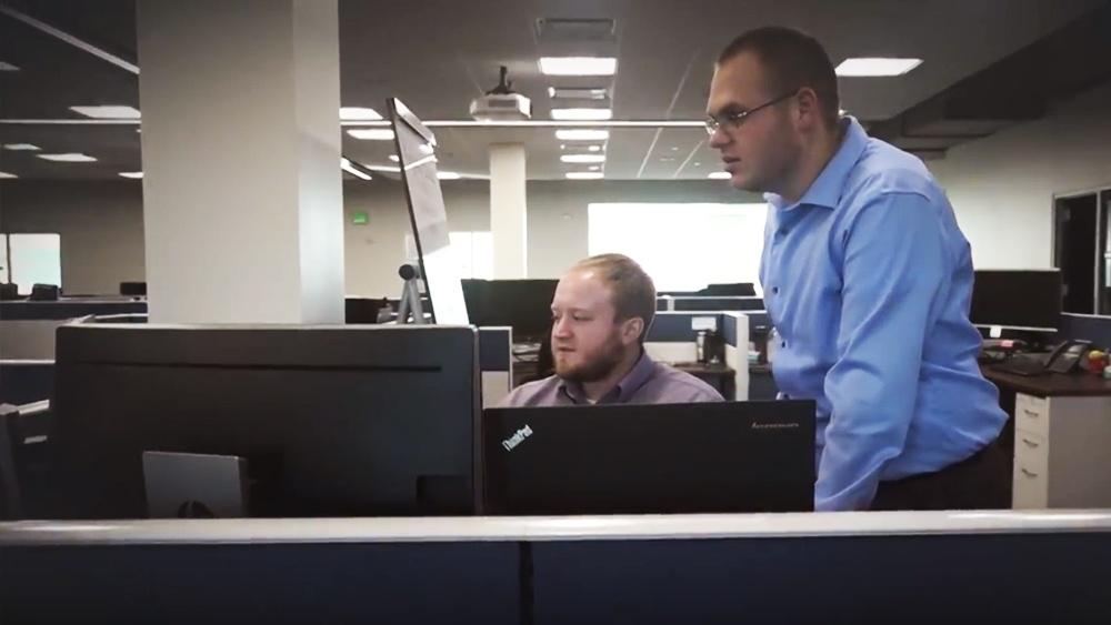 Kingland Employees Working on Solution